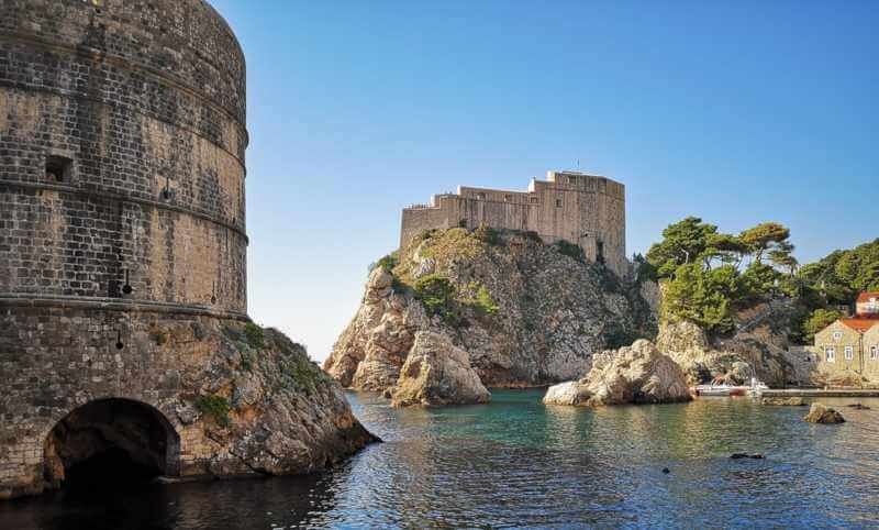 beauty of its stone walls and streets and the clarity of its blue sea